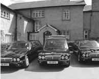 Daimler hearse and limousines